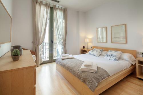 Habitat Apartments Alibei客房内的一张或多张床位
