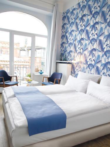 弗里茨普亚马酒店客房内的一张或多张床位