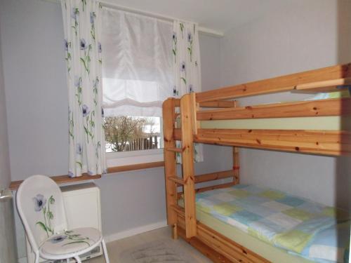 安德尔奎勒度假屋客房内的一张或多张双层床