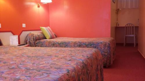 Maison Hôtel Restaurant Aux Cerisiers客房内的一张或多张床位