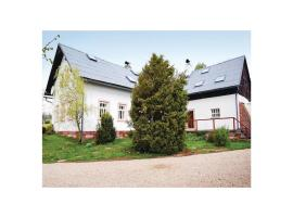 Four-Bedroom Holiday Home in Hostinne
