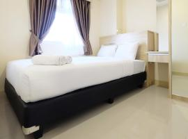 Clean And Tidy 2BR Green Pramuka Apartement By Travelio