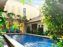天堂椰林之家酒店,位于金巴兰的旅馆