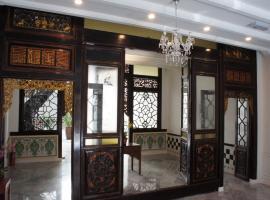 希伦棕榈套房酒店