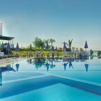 埃罗萨萨摩奇海滩公寓套房酒店