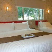 Carlsun Hotel,位于古来苏丹依斯迈路机场 - JHB附近的酒店